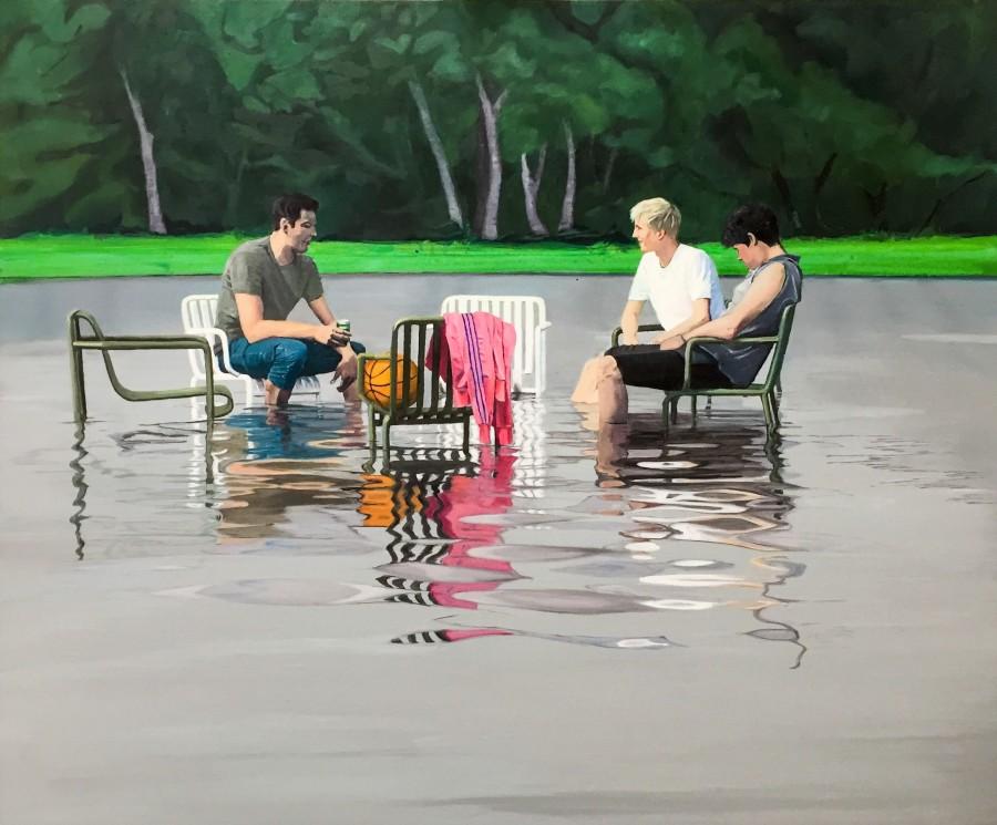 tre unge mænd sidder på stole der står i vand